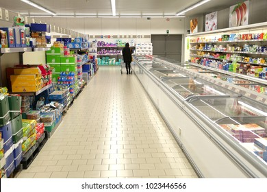 KORTRIJK, BELGIUM -JANUARY 30ST 2018:A shopping aisle with only one person browsing through the products, in the famous German supermarket Aldi. The deep freeze area in the shop.Illustrative editorial