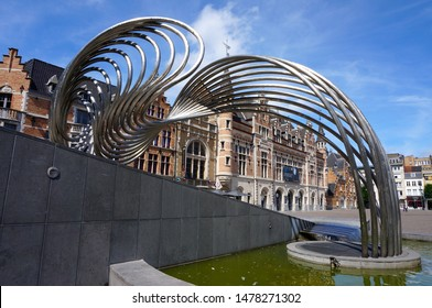 """Kortrijk, Belgium - June 22 2019: Fountain """"De Golf"""" (The Wave) on top of the entrance to the underground car park."""