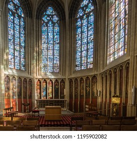 Kortrijk, Flanders, Belgium - September 17, 2018: Chancel of historic chapel in Notre Dame Church honoring all Dukes of Flanders through the ages. Stained glass windows and series of paintings.