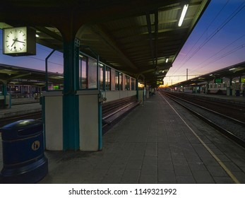 Kortrijk, West Flanders / Belgium - October 15th 2011: 19h20 at the Kortrijk Station view from the platform by sunset, typical Flanders Belgium Station.