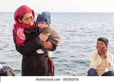 Kos, Greece, circa October 2015. Uzbeck family from Afghanistan at the Aegean Sea after arriving to Kos from Turkey earlier that day.