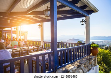 KOS, GREECE - JULY 16, 2018: Restaurant view in Zia village. Zia has the most beautiful sunset view of the island and is a famous attraction among tourists.