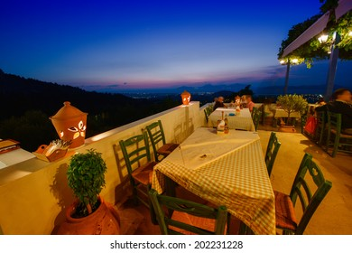 KOS, GREECE - JUNE 6, 2014: Restaurant view at night in Zia village. Zia has the most beautiful sunset view of the island and is a famous attraction among tourists.
