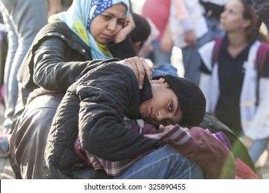 Kos, Greece - October 10, 2015: Syrian refugee and her child at a volunteer's camp