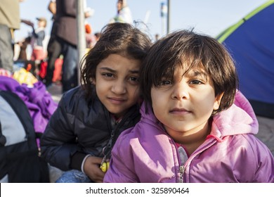 Kos, Greece - October 10, 2015: Syrian children in volunteers aid point.
