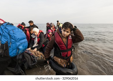 Kos, Greece - October 17, 2015: Child is leaving the dinghy boat on the Greek coast