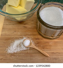 Kosher salt and butter on wooden cutting board