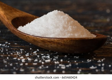 Kosher salt on a wooden spoon