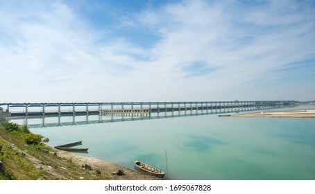 The Koshi Barrage is a sluice across the Koshi river that carries vehicular, bicycle, and pedestrian traffic between Saptari district and Sunsari district of Nepal.
