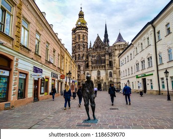 Kosice, Slovakia - April 26, 2018: People walking at central square the painter Julius Jakoby statue And St. Elizabeth Cathedral