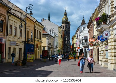 Kosice, Slovakia - April 27, 2018: People walking at Mlynska street, near St Elisabeth Cathedral