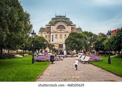 KOSICE, SLOVAKIA - AUGUST 20, 2014: Main street in city center with State Theatre in the evening in Kosice, Slovakia, August 20, 2014.