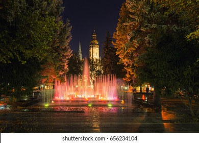 Kosice, Slovakia.  Evening View At The Singing Fountains ( Spievajuca Fontana )  And Saint Elisabeth Cathedral On The Main Square Of The Old Town. Famous Landmark Of The City And The Whole Country.