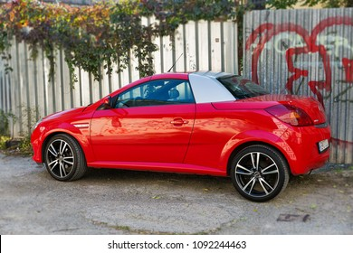 KOSICE, SLOVAKIA - OCTOBER 02, 2017: Red luxury coupe Opel Tigra TwinTop parked. It is a two seater coupe convertible with a retractable hardtop. Opel is a German automobile manufacturer.