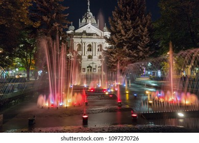KOSICE, SLOVAKIA - OCTOBER 02, 2017: Singing fountain and State Opera Theater at night in Old Town. Kosice is the largest city in eastern Slovakia and in 2013 was the European Capital of Culture.