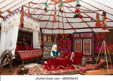 Kostanay, Kazakhstan - may 15, 2016, are:the interior of the Kazakh Yurt with a dummy of a woman in national costume,: city Museum. The interior of the ethnic Yurt of the nomadic house