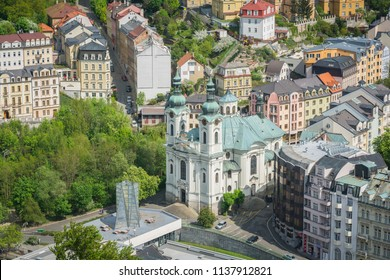 Kostel Maří Magdalény, the catholic church inside Karlovy Vary town taken from hill near the town, Karlovy Vary, Czech Republic, May 2nd 2018