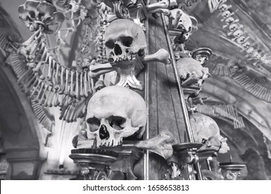 Kostnice Church in Kutna Hora with Ossuary interior decoration from human bones and skulls, in black-and-white color Czech republic, 9 June, 2018