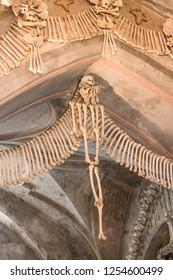 Kostnice in Sedci Czech Republic - October 2017: Human skulls and bones in a church in Kutna Hora.