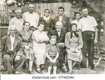 KOSTOPIL,UKRAINE, SEPTEMBER 30, 1960 - Vintage photo of farmers family