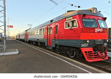 Kostroma, Kostroma region, Russia, April 13, 2018. The passenger train arrives at the railway station.Translation of the inscription is forbidden to stand on the edge of the platform.