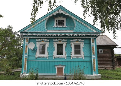 KOSTROMA REGION, RUSSIAN FEDERATION - AUGUST 26, 2016: Blue rural wooden house with carved windows in Russian village (Kostroma oblast, Russia). Russian style in architecture