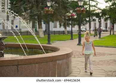 Kostroma, Russia, August 10, 2017. People stroll by the fountain near the shopping streets.