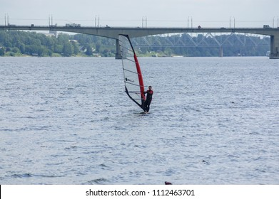 Kostroma / Russia - July 28, 2007: sportsman windsurfing on the Volga River at summer windy day