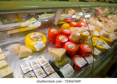 """KOSTROMA, RUSSIA - MAY 07, 2017: The production of the Kostroma region's cheese factories on the counter of the """"Kostroma cheese exchange"""""""