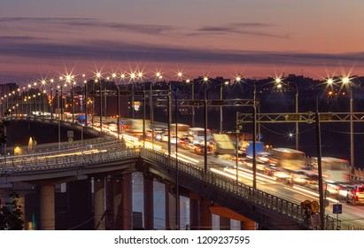 Kostroma, Russia - September 14, 2018: Light trails on the Bridge over the Kostroma river after sunset.
