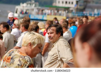 Kostroma/Russia - August 23, 2008: Celebration the day of the Kostroma city. People are watching the parade of river ships on Volga river embankment