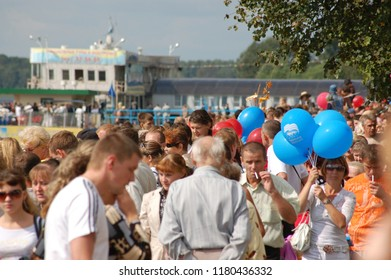 Kostroma/Russia - August 23, 2008: Celebration the day of the Kostroma city. People are watching the parade of river ships on the embankment of Volga