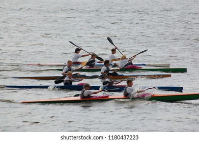 Kostroma/Russia - August 23, 2008: Celebration the day of the Kostroma city. Rowers with oars on boats on the parade of ships on the Volga River