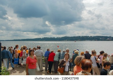 Kostroma/Russia - August 23, 2008: Celebration the day of the Kostroma city. People are waiting for the beginning of the parade of river ships