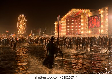 KOSTRZYN NAD ODRA, POLAND - AUGUST 2, 2014: Funs dancing in the water during concert at the Festival Przystanek Woodstock. Przystanek Woodstock is the biggest open music festival in Europe.
