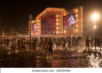 KOSTRZYN NAD ODRA, POLAND - AUGUST 2, 2014: People have fun during a concert of Coma at the Festival Przystanek Woodstock. Przystanek Woodstock is one of the biggest open air music festivals in Europe.
