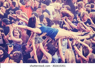 KOSTRZYN NAD ODRA, POLAND - AUGUST 1, 2015: People having fun during concert on the 21th Woodstock Festival Poland, one of the biggest open air festivals in Europe, vintage toned.