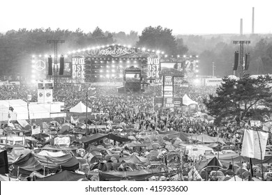 KOSTRZYN NAD ODRA, POLAND - AUGUST 1, 2015: Black and white picture of main stage and tents at the 21th Woodstock Festival Poland (Przystanek Woodstock).