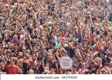 Kostrzyn, Poland - August 03, 2017: Applauding crowd at the 23rd Woodstock Festival Poland opening ceremony. Festival is among the biggest open air festivals in the world.