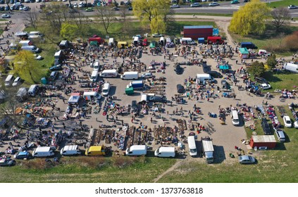 KOSZALIN, POLAND - 07 APRIL 2019 - Aerial view on Koszalin's Gielda miscellaneous sunday market filled with crowds of buyers and seller's makeshift stands.