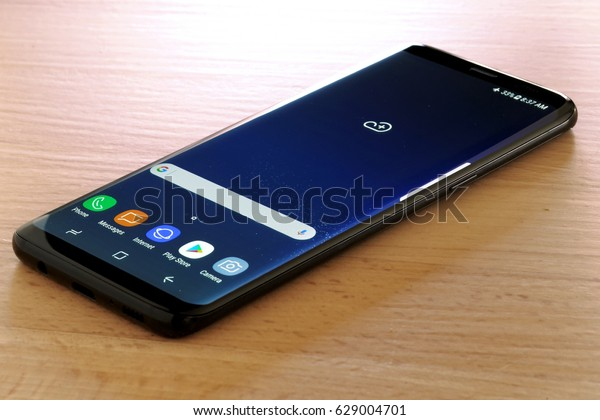 Koszalin, Poland - 27 April, 2017: Black Samsung Galaxy S8 on stone table. Samsung S8 are the new generation of smartphones from Samsung. The Samsung S8 is smart phone with multi touch screen