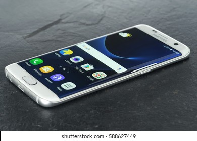 Koszalin, Poland – February 27, 2016: Photo of Samsung Galaxy S7 Edge white pearl. Samsung 7 Edge are new generation smartphone from Samsung. The Samsung S7 Edge is smart phone with multi touch screen