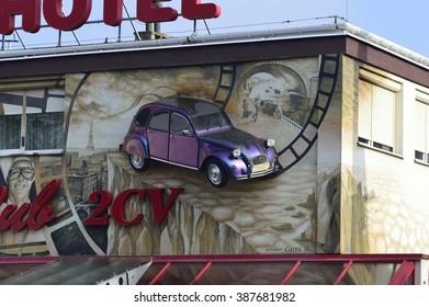 Koszalin, Poland, March 07 , 2016: A cult car Citroen 2CV installed in the wall of the building in Koszalin.