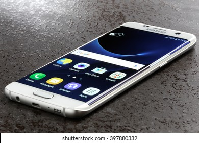 Koszalin, Poland  March 29, 2016: Photo of Samsung Galaxy S7 Edge on a table. Samsung 7 Edge are new generation smartphone from Samsung. The Samsung S7 Edge is smart phone with multi touch screen.