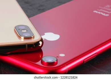 Koszalin, Poland – November 12, 2018: Golden iPhone XS Max and red iPhone XR. The iPhone XS Max and iPhone XR is smart phone with multi touch screen produced by Apple Computer, Inc.