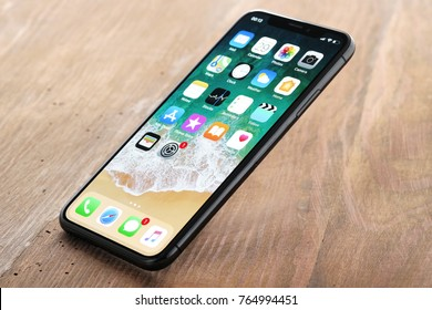 Koszalin, Poland – November 29, 2016: Space gray iPhone X on wooden table. The iPhone X is smart phone with multi touch screen produced by Apple Computer, Inc.