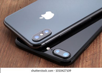 Koszalin, Poland – November 29, 2017: Space gray iPhone X and black iPhone 7 on wooden table. The iPhone X and iPhone 7 is smart phone with multi touch screen produced by Apple Computer, Inc.