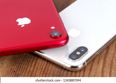 Koszalin, Poland – November 29, 2018: Silver iPhone Xs and red iPhone XR. The iPhone Xs and iPhone XR is smart phone with multi touch screen produced by Apple Computer, Inc.