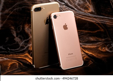 Koszalin, Poland- October  06 , 2016: Golden iPhone 7 Plus and pink iPhone 7.. The iPhone 7 Plus and iPhone 7 is smart phone with multi touch screen produced by Apple Computer, Inc.