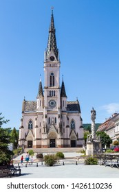 Koszeg / Hungary - June 9 2019: The Jesus' Heart neogothic historicizing Church with the Holy Trinity Sculpture